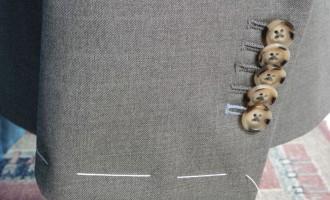 Hoe mouwen colbert korter maken